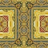 被雕刻的金黄装饰品的图象 库存照片