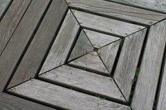被风化的木正方形倾斜对一边 免版税库存图片