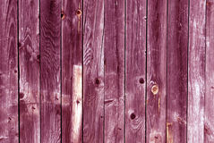 被风化的桃红色木墙壁纹理 库存照片