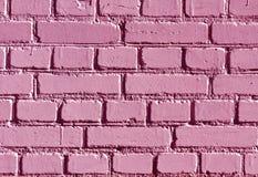 被风化的桃红色颜色砖墙样式 库存照片