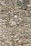 被风化的石墙 免版税库存图片