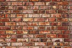被风化的红砖墙壁背景 库存照片