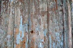 被风化的老剥落的木蓝色tourquoise油漆 库存照片