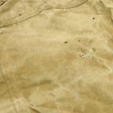 被风化的老淡绿色的陷井织品背景 免版税库存图片