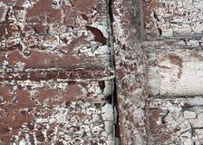 被风化的脏的被绘的木墙壁纹理 免版税库存图片