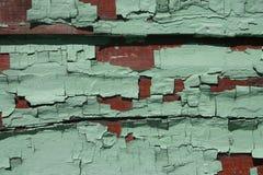 被风化的董事会绿色红色 库存照片