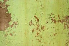 被风化的锡被绘的表面 免版税库存照片