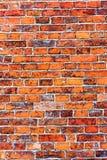 被风化的难看的东西红砖墙壁当背景纹理 免版税库存图片