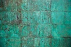 被风化的,被氧化的铜墙壁结构 免版税图库摄影