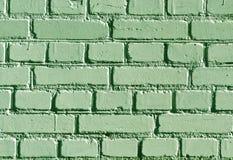 被风化的绿色砖墙样式 库存照片
