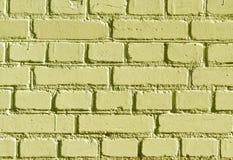 被风化的黄色颜色砖墙样式 免版税库存照片