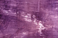 被风化的紫色cament墙壁表面 库存照片