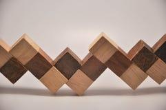 被延伸的立方体木玩具 图库摄影