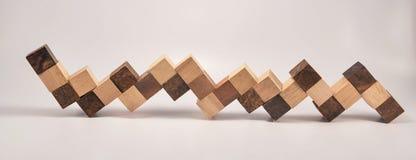 被延伸的立方体木玩具 库存照片