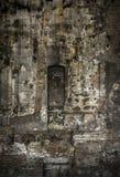 被破坏的房子墙壁  免版税库存照片