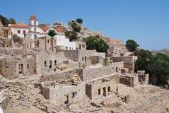被破坏的村庄,蒂洛斯岛 免版税库存照片
