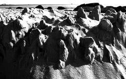 被破坏的沙子城堡 免版税图库摄影