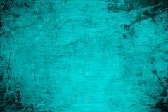 被破坏的背景霓虹蓝色墙壁纹理摘要难看的东西抓了纹理 免版税库存照片