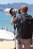 被寻找的猎人,无固定职业的摄影师在戛纳 免版税库存照片