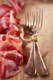 被治疗的肉和葡萄酒叉子 库存照片