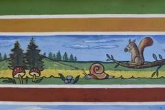 被绘的卡通效果风景墙壁 免版税图库摄影