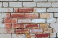 被绘的砖墙 免版税库存照片