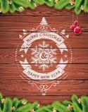 被绘的葡萄酒圣诞快乐和与redglass球的新年快乐印刷设计在木纹理背景 库存照片