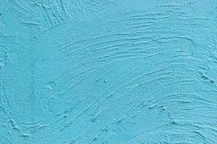 被绘的蓝色水泥墙壁 库存照片