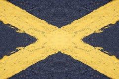被绘的黄色十字架 库存照片