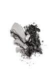 被击碎的石墨和灰色二重奏眼影膏 库存图片