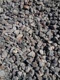 被击碎的石头背景  免版税库存照片