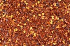 被击碎的红辣椒片特写镜头食物背景纹理 免版税库存图片