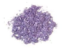 被击碎的紫色眼影膏 库存图片