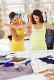 裁缝评定的客户机 库存照片