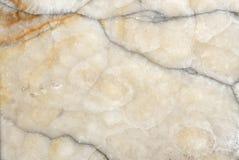 破裂的米黄大理石纹理背景 库存图片