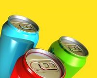 装五颜六色的饮料三于罐中 免版税库存照片