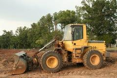 装入程序拖拉机轮子 库存照片