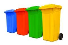 装收集五颜六色的大垃圾于罐中 库存照片