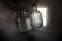 装瓶有薄雾被日光照射了 免版税库存照片