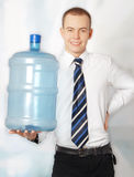 装瓶生意人微笑的水年轻人 免版税库存图片