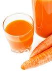 装瓶用红萝卜汁 免版税库存图片