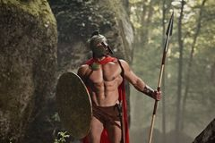 装甲的肌肉罗马战士 免版税库存照片