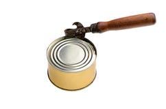 装罐在西红柿酱的沙丁鱼与在白色隔绝的开罐头用具 库存照片