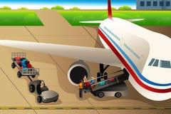装载行李的工作者入一架飞机在机场 库存例证