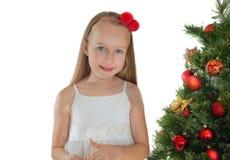 装饰女孩的圣诞节少许查出在结构树白色 免版税库存照片