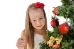 装饰女孩的圣诞节少许查出在结构树白色 库存图片