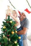 装饰少许结构树的男孩圣诞节 免版税图库摄影