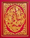 装饰的龙金黄红色木头 图库摄影