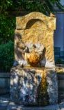 装饰石饮用水喷泉 免版税库存图片