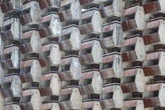 装饰老未完成的旅馆的标准屋子的被毁坏的阳台作为背景或背景 免版税库存图片